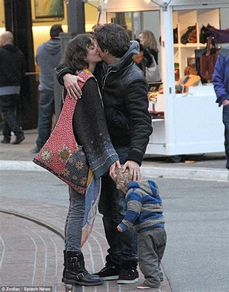 Marion Cotillard French kisses her beau Guillaume Canet on