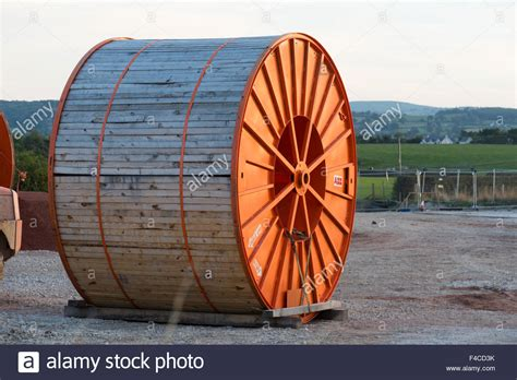 Large orange cable drum to be used for underground link